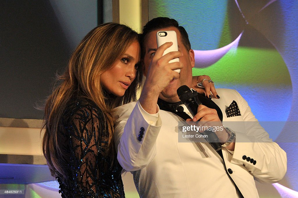 Recording artist Jennifer Lopez (L) and TV personality Ross Mathews taking a selfie onstage during the 25th Annual GLAAD Media Awards at The Beverly Hilton Hotel on April 12, 2014 in Los Angeles, California.