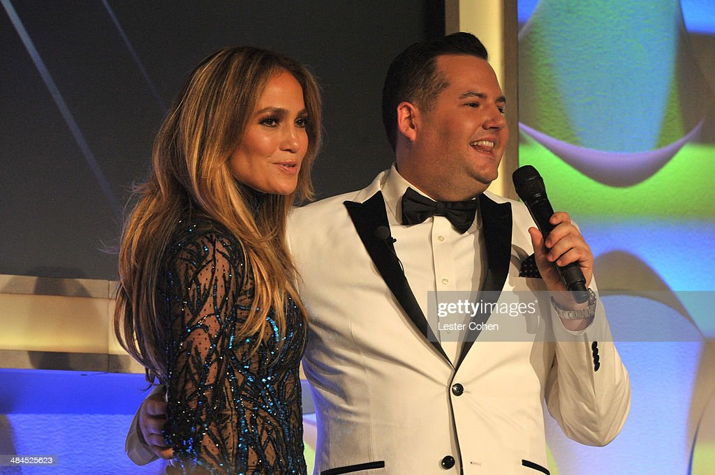 Recording artist Jennifer Lopez (L) and TV personality Ross Mathews onstage during the 25th Annual GLAAD Media Awards at The Beverly Hilton Hotel on April 12, 2014 in Los Angeles, California.