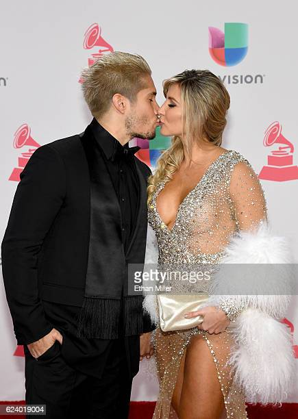Recording artist Jesús Alberto Miranda Perez of Chino and Natasha Araos attend The 17th Annual Latin Grammy Awards at TMobile Arena on November 17...