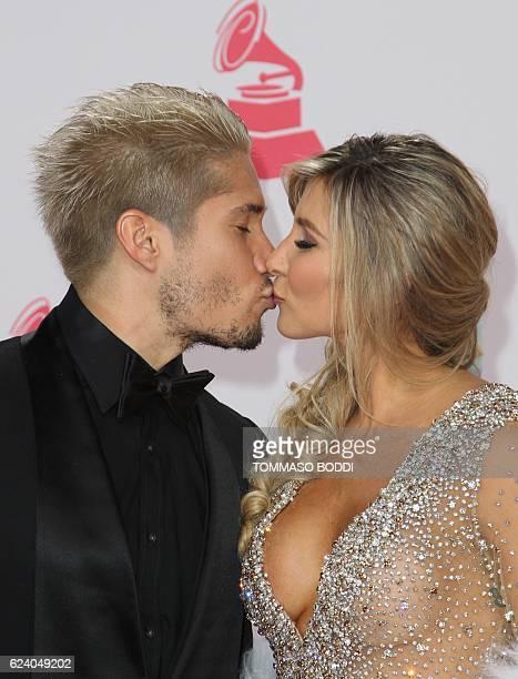 Recording artist Jesús Alberto Miranda Perez of Chino and Natasha Araos arrive for the 17th Annual Latin Grammy Awards on November 17 in Las Vegas...