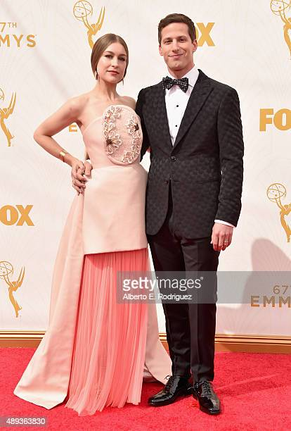 Recording artist Joanna Newsom and host Andy Samberg attend the 67th Emmy Awards at Microsoft Theater on September 20 2015 in Los Angeles California...