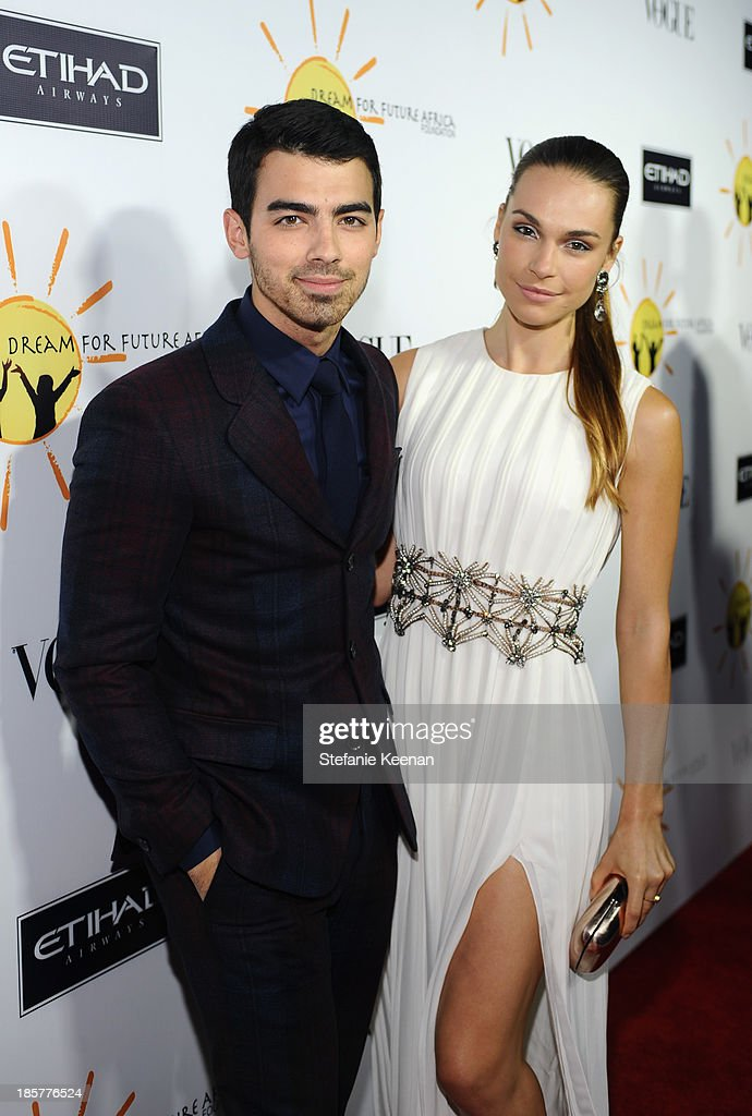 Recording Artist <a gi-track='captionPersonalityLinkClicked' href=/galleries/search?phrase=Joe+Jonas&family=editorial&specificpeople=842712 ng-click='$event.stopPropagation()'>Joe Jonas</a> and Blanda Eggenschwiler attend Dream for Future Africa Foundation Inaugural Gala honoring Franca Sozzani of VOGUE Italia at Spago on October 24, 2013 in Beverly Hills, California.