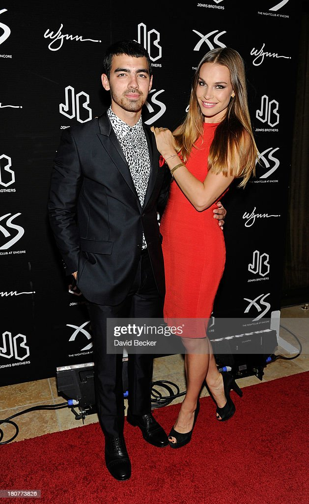 Recording artist Joe Jonas (L) and model Blanda Eggenschwiler arrive at XS The Nightclub at Encore Las Vegas to celebrates Nick Jonas's 21st birthday on September 16, 2013 in Las Vegas, Nevada.
