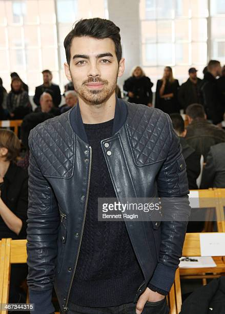 Recording artist Joe Jonas attends the Duckie Brown show during MercedesBenz Fashion Week Fall 2014 at Industria Superstudio on February 6 2014 in...