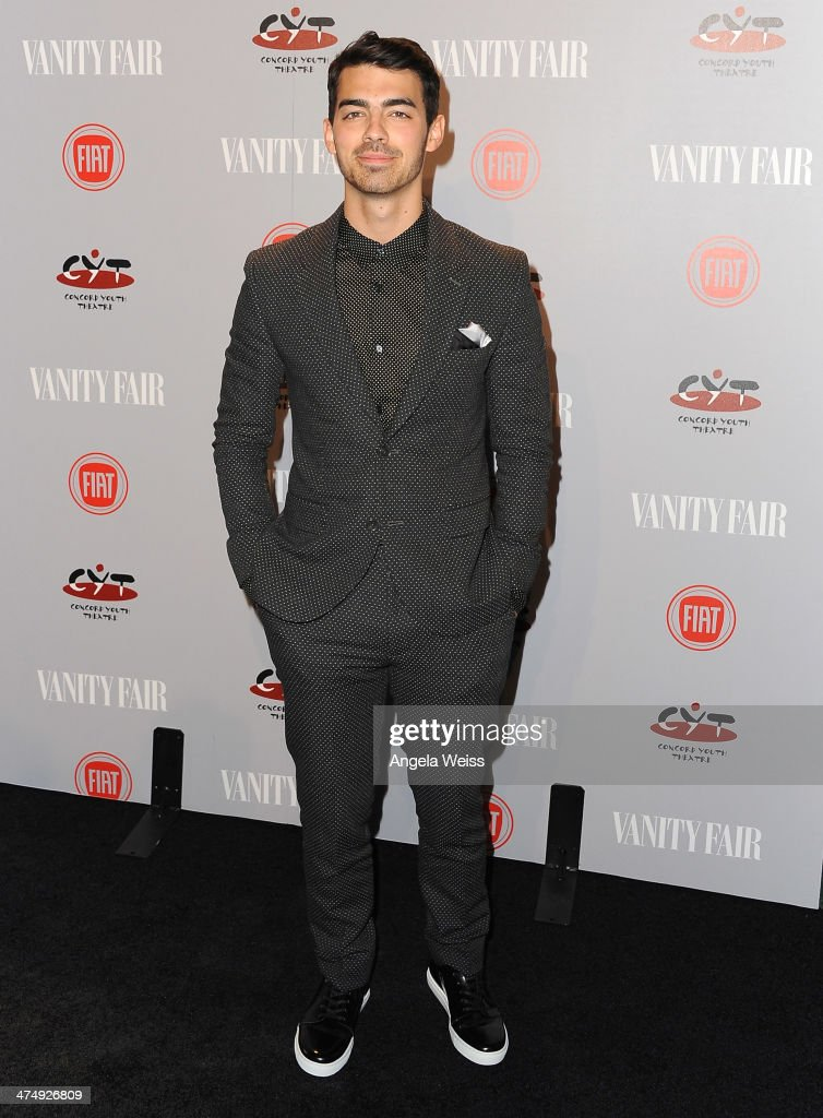 Recording artist <a gi-track='captionPersonalityLinkClicked' href=/galleries/search?phrase=Joe+Jonas&family=editorial&specificpeople=842712 ng-click='$event.stopPropagation()'>Joe Jonas</a> attends the Vanity Fair Campaign Hollywood 'Young Hollywood' party sponsored by Fiat at No Vacancy on February 25, 2014 in Los Angeles, California.