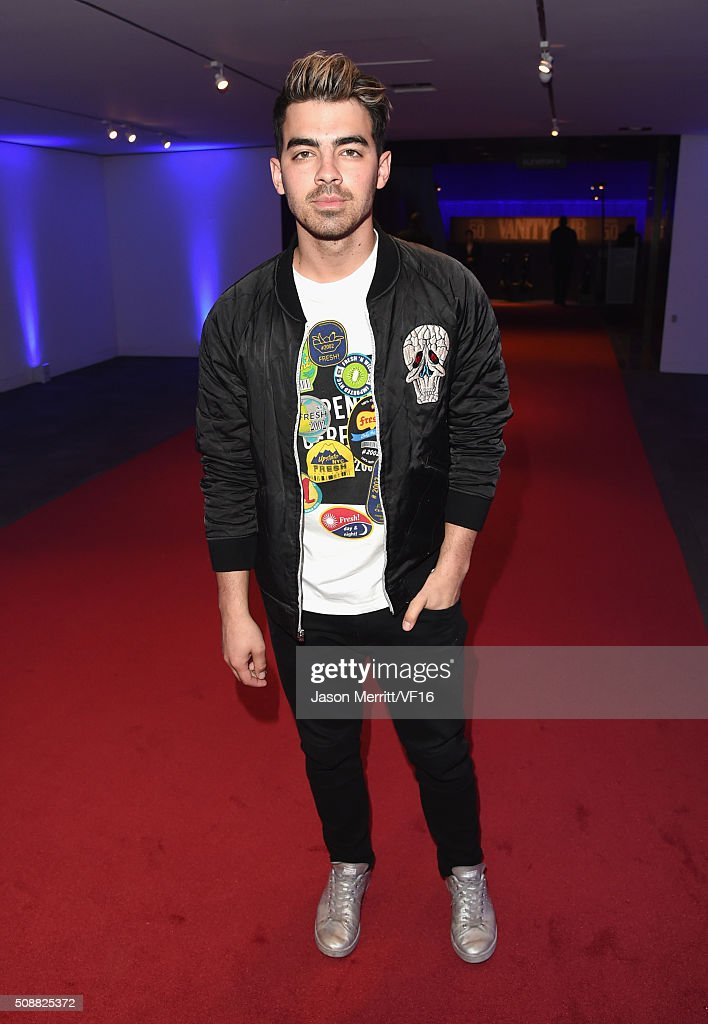Recording artist <a gi-track='captionPersonalityLinkClicked' href=/galleries/search?phrase=Joe+Jonas&family=editorial&specificpeople=842712 ng-click='$event.stopPropagation()'>Joe Jonas</a> attends the Vanity Fair Super Bowl Party, hosted by Graydon Carter & Jon Bon Jovi, Honors Super Bowl 50 Host Committee & 50 Fund, Sponsored by Lands End on February 6, 2016 in San Francisco, California.