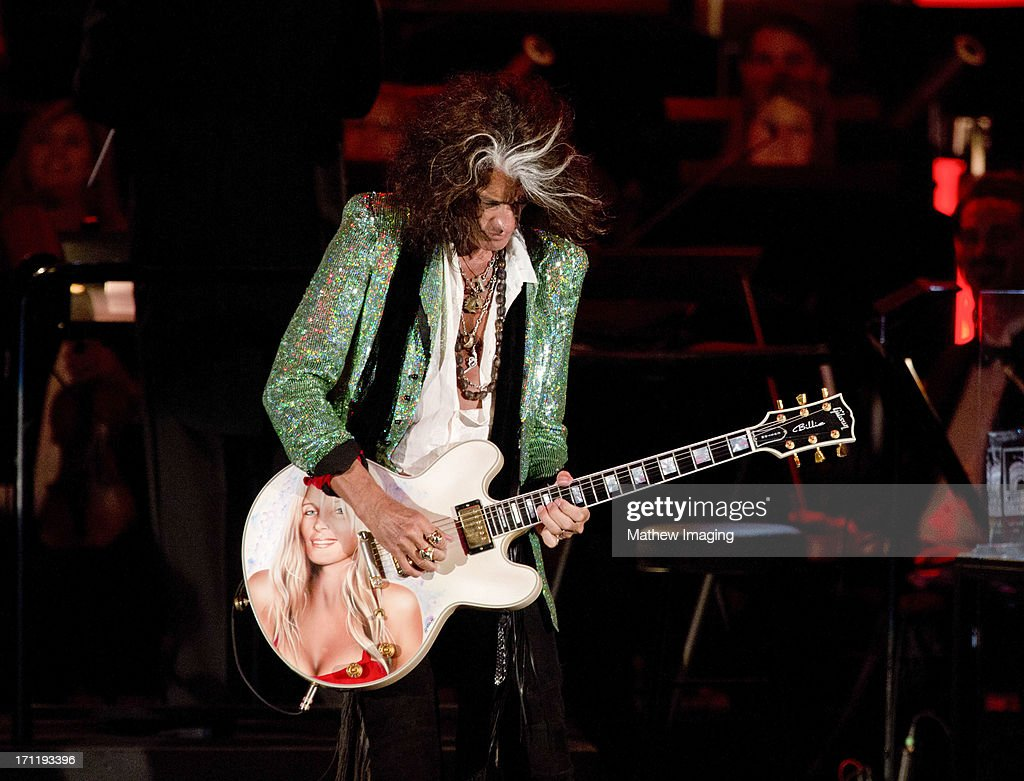 Recording artist <a gi-track='captionPersonalityLinkClicked' href=/galleries/search?phrase=Joe+Perry+-+M%C3%BAsico&family=editorial&specificpeople=13600677 ng-click='$event.stopPropagation()'>Joe Perry</a> performs at Hollywood Bowl Opening Night Gala - Inside at The Hollywood Bowl on June 22, 2013 in Los Angeles, California.