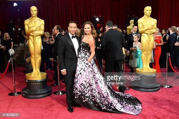 Recording artist John Legend and his wife model Christine Teigen attend the Oscars held at Hollywood Highland Center on March 2 2014 in Hollywood...