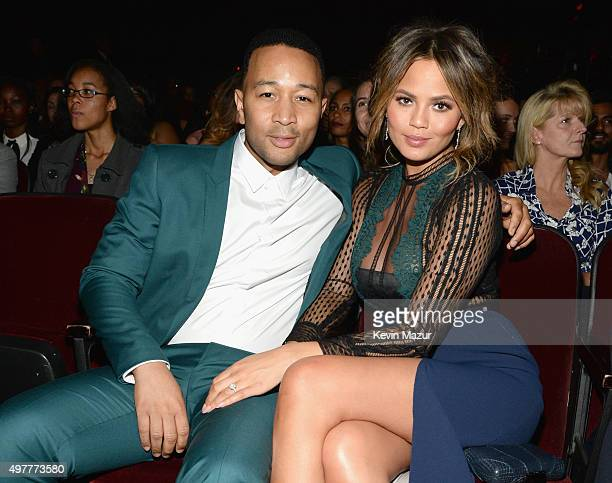 Recording artist John Legend and model Chrissy Teigen attend AE Networks 'Shining A Light' concert at The Shrine Auditorium on November 18 2015 in...