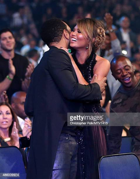 Recording artist John Legend and model Chrissy Teigen attend the 2015 MTV Video Music Awards at Microsoft Theater on August 30 2015 in Los Angeles...