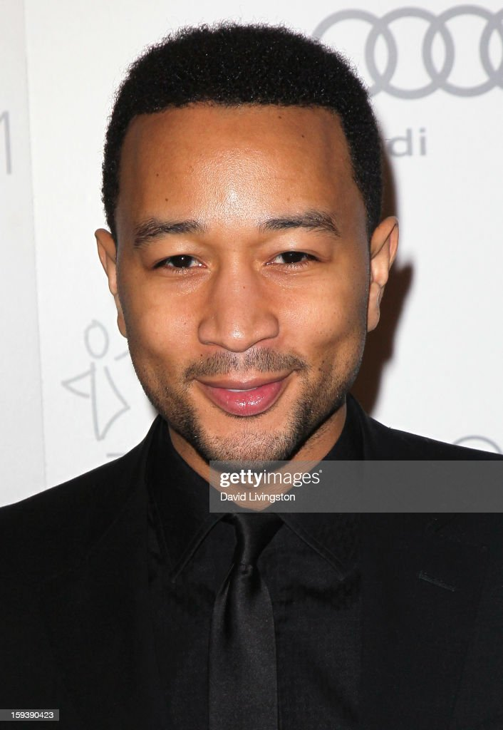 Recording artist John Legend attends the Art of Elysium's 6th Annual Black-tie Gala 'Heaven' at 2nd Street Tunnel on January 12, 2013 in Los Angeles, California.
