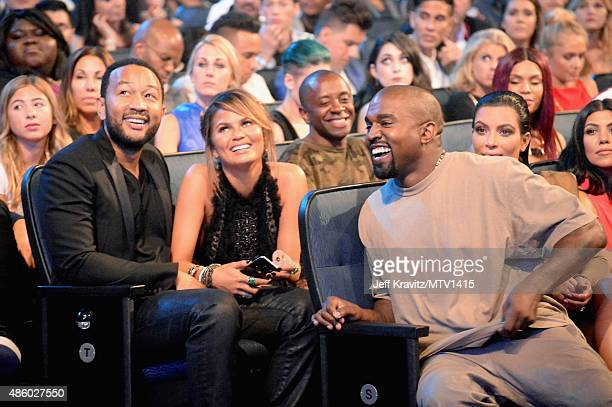 Recording artist John Legend model Chrissy Teigen and recording artist Kanye West attend the 2015 MTV Video Music Awards at Microsoft Theater on...