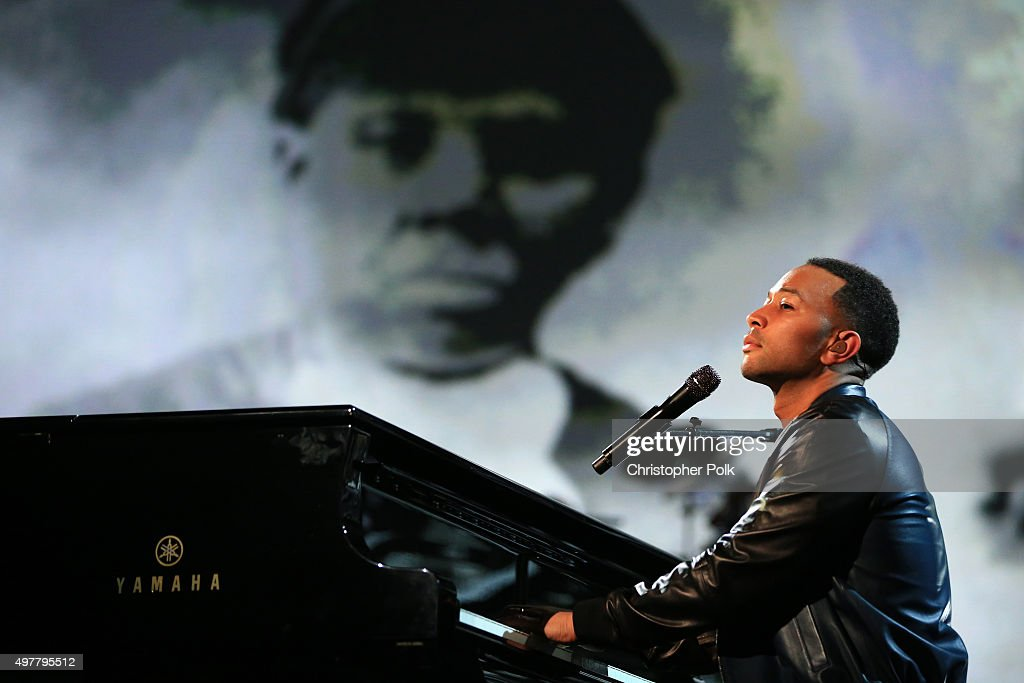 Recording artist John Legend performs onstage at A+E Networks 'Shining A Light' concert at The Shrine Auditorium on November 18, 2015 in Los Angeles, California.