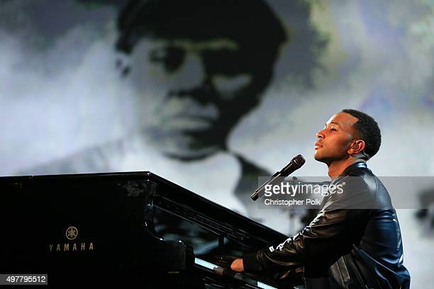 Recording artist John Legend performs onstage at AE Networks 'Shining A Light' concert at The Shrine Auditorium on November 18 2015 in Los Angeles...
