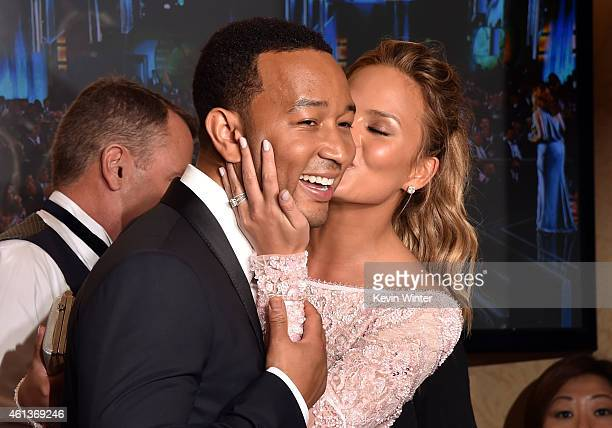 Recording artist John Legend winner of Best Original Song Motion Picture for 'Glory' with model Chrissy Teigen in the press room during the 72nd...