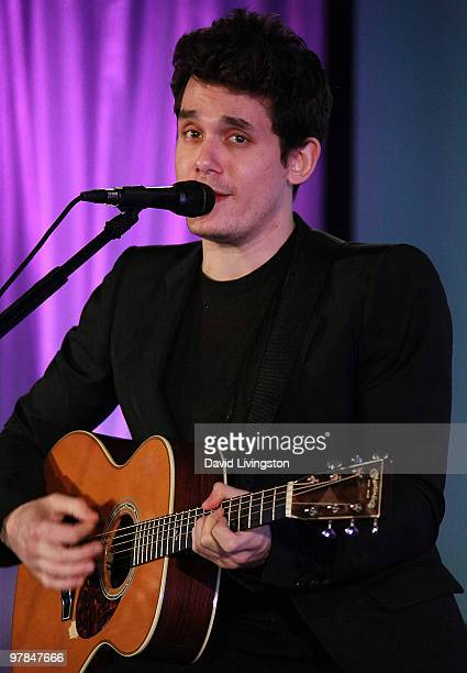 Recording artist John Mayer performs on stage at Ferrari's charity auction of it's 1st Ferrari 458 Italia in North America at Fleur de Lys on March...