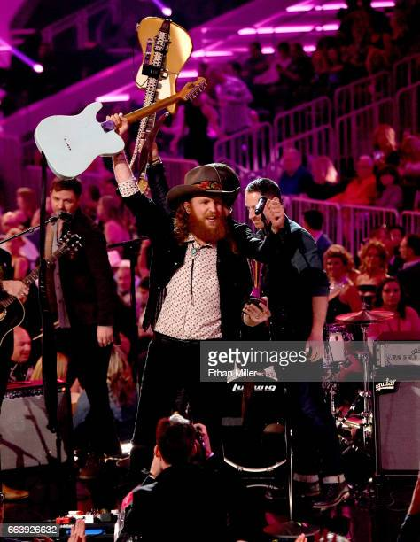 Recording artist John Osborne of music group Brothers Osborne accepts the New Vocal Duo or Group of the Year award presented by TMobile onstage...
