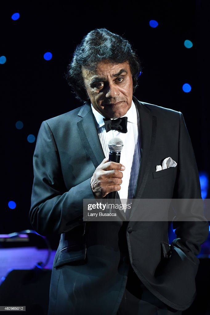 Recording artist Johnny Mathis performs onstage during the PreGRAMMY Gala and Salute To Industry Icons honoring Martin Bandier at The Beverly Hilton...