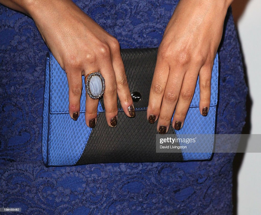 Recording artist Jordin Sparks (purse & ring detail) attends the VH1 Divas After Party to benefit the VH1 Save The Music Foundation at the Shrine Expo Hall on December 16, 2012 in Los Angeles, California.