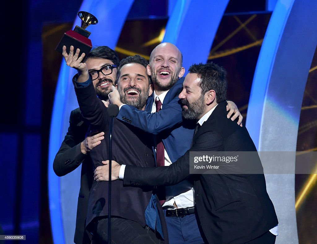 Recording artist Jorge Drexler (L) producer Sebastian Merlin (2nd R) and producer Carles Campi Campon (R) accept the Record of the Year award for 'Universos Paralelos' onstage during the 15th annual Latin GRAMMY Awards at the MGM Grand Garden Arena on November 20, 2014 in Las Vegas, Nevada.