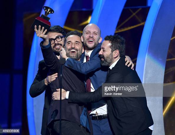 Recording artist Jorge Drexler producer Sebastian Merlin and producer Carles Campi Campon accept the Record of the Year award for 'Universos...