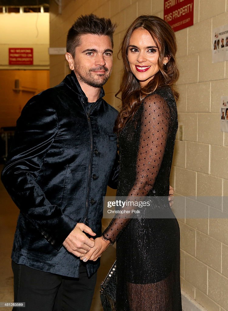 Recording Artist <a gi-track='captionPersonalityLinkClicked' href=/galleries/search?phrase=Juanes&family=editorial&specificpeople=202467 ng-click='$event.stopPropagation()'>Juanes</a> (R) and actress <a gi-track='captionPersonalityLinkClicked' href=/galleries/search?phrase=Karen+Martinez&family=editorial&specificpeople=2709460 ng-click='$event.stopPropagation()'>Karen Martinez</a> pose backstage during the 14th Annual Latin GRAMMY Awards held at the Mandalay Bay Events Center on November 21, 2013 in Las Vegas, Nevada.