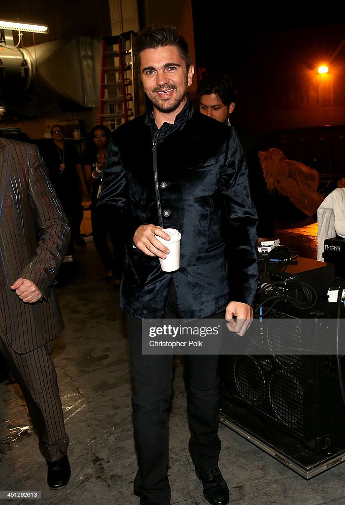 Recording artist <a gi-track='captionPersonalityLinkClicked' href=/galleries/search?phrase=Juanes&family=editorial&specificpeople=202467 ng-click='$event.stopPropagation()'>Juanes</a> poses backstage during the 14th Annual Latin GRAMMY Awards held at the Mandalay Bay Events Center on November 21, 2013 in Las Vegas, Nevada.