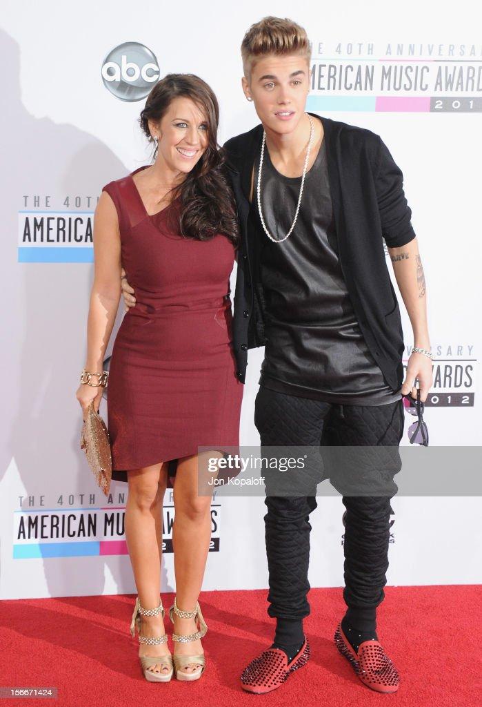Recording artist Justin Bieber and mom Pattie Mallette arrive at The 40th American Music Awards at Nokia Theatre LA Live on November 18 2012 in Los...