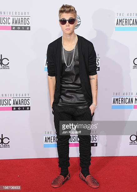Recording artist Justin Bieber arrives at The 40th American Music Awards at Nokia Theatre LA Live on November 18 2012 in Los Angeles California