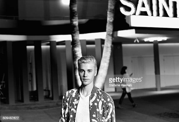 Recording artist Justin Bieber in Saint Laurent by Hedi Slimane attends Saint Laurent at the Palladium on February 10 2016 in Los Angeles California...