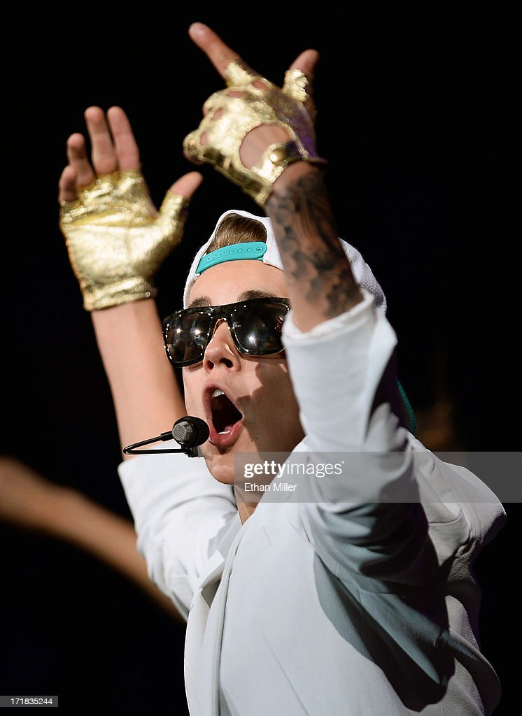 Recording artist <a gi-track='captionPersonalityLinkClicked' href=/galleries/search?phrase=Justin+Bieber&family=editorial&specificpeople=5780923 ng-click='$event.stopPropagation()'>Justin Bieber</a> performs during his Believe Tour at the MGM Grand Garden Arena on June 28, 2013 in Las Vegas, Nevada.