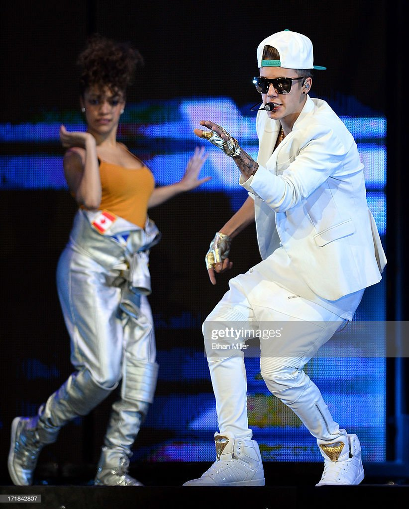 Recording artist Justin Bieber (R) performs during his Believe Tour at the MGM Grand Garden Arena on June 28, 2013 in Las Vegas, Nevada.