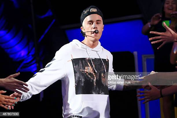 Recording artist Justin Bieber performs onstage during the Think It Up education initiative telecast for teachers and students hosted by...