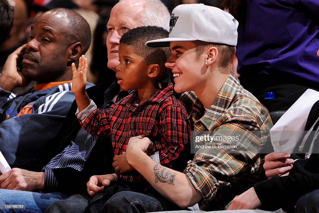 Recording artist Justin Bieber sits with Christopher Emmanuel Paul ll, son of Chris Paul of the Los Angeles Clippers, during a game between the Boston Celtics and Clippers on December 27, 2012 at the Staples Center in Los Angeles, California.