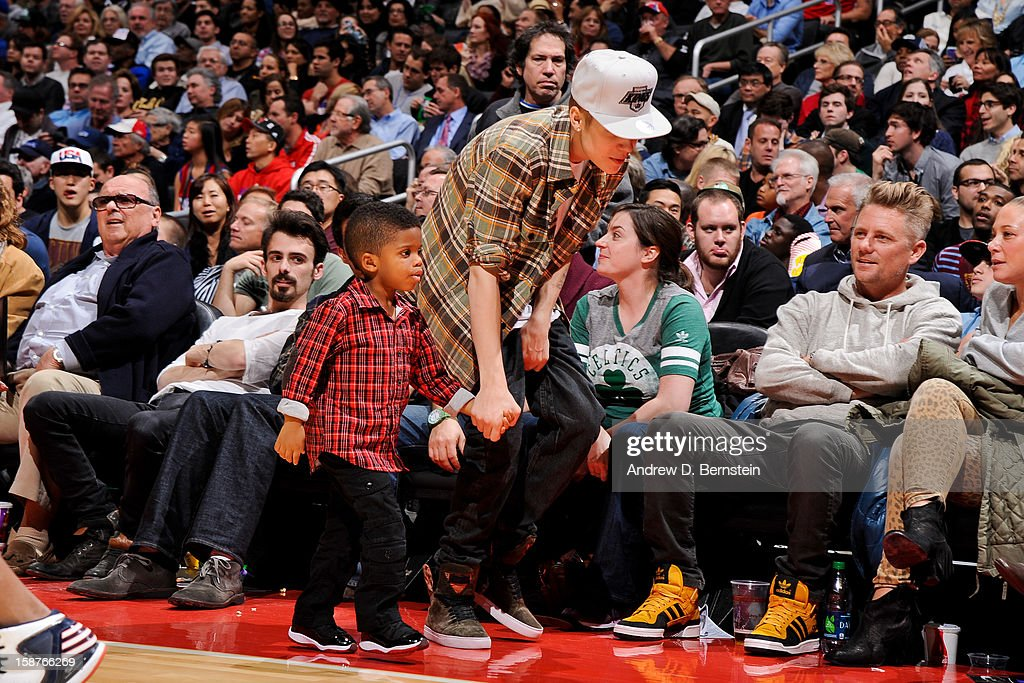 Recording artist Justin Bieber walks with Christopher Emmanuel Paul ll, son of Chris Paul of the Los Angeles Clippers, during a game between the Boston Celtics and Clippers on December 27, 2012 at the Staples Center in Los Angeles, California.