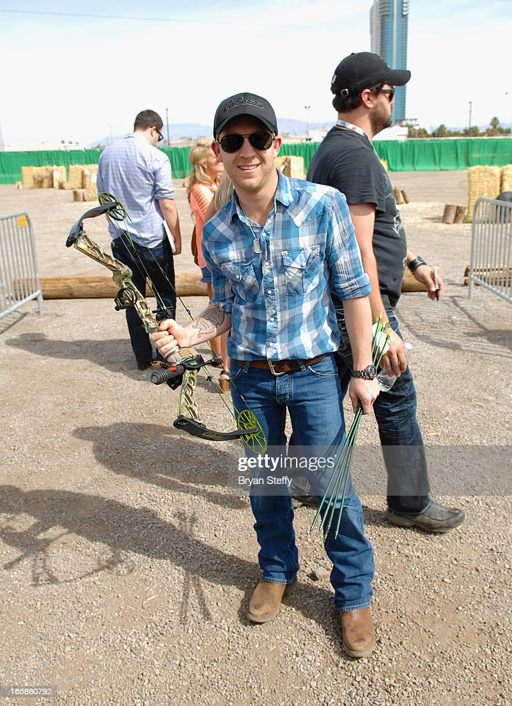 Recording artist <a gi-track='captionPersonalityLinkClicked' href=/galleries/search?phrase=Justin+Moore&family=editorial&specificpeople=2437772 ng-click='$event.stopPropagation()'>Justin Moore</a> attends the 48th Annual Academy Of Country Music Awards & Cabela's Great Outdoors Archery event at the Orleans Arena on April 6, 2013 in Las Vegas, Nevada.