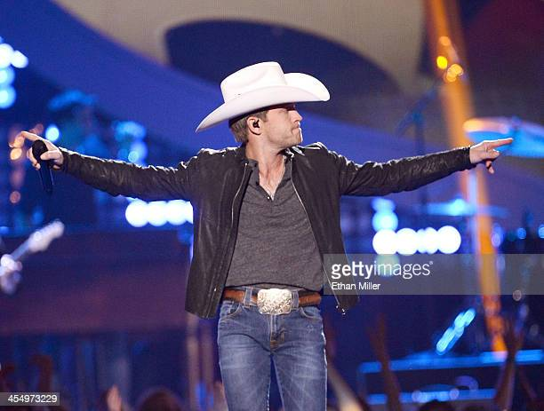 Recording artist Justin Moore performs onstage during the American Country Awards 2013 at the Mandalay Bay Events Center on December 10 2013 in Las...