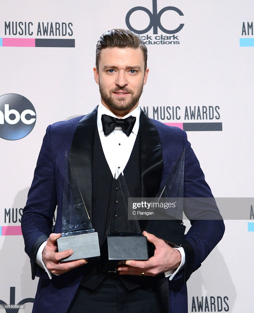 Recording artist <a gi-track='captionPersonalityLinkClicked' href=/galleries/search?phrase=Justin+Timberlake&family=editorial&specificpeople=157482 ng-click='$event.stopPropagation()'>Justin Timberlake</a>, winner of Favorite Male Artist - Pop/Rock, Favorite Male Artist - Soul/R&B, and Favorite Album - Soul/R&B for 'The 20/20 Experience,' poses in the press room at the 2013 American Music Awards at Nokia Theatre L.A. Live on November 24, 2013 in Los Angeles, California.