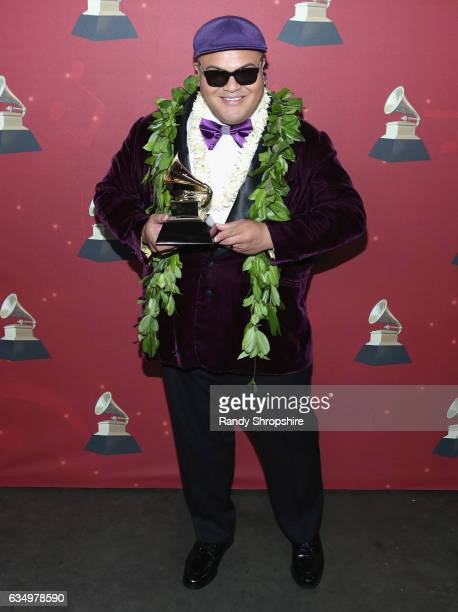 Recording artist Kalani Pe'a poses with the Best Regional Music Album award backstage at the Premiere Ceremony during the 59th GRAMMY Awards at...