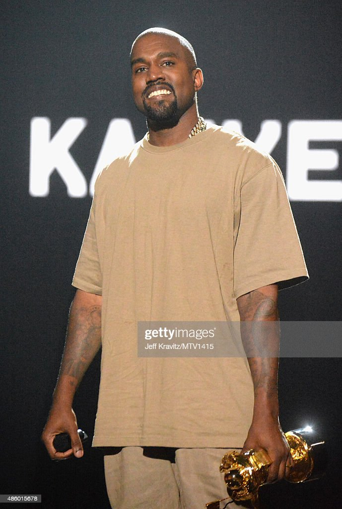 Recording artist <a gi-track='captionPersonalityLinkClicked' href=/galleries/search?phrase=Kanye+West+-+Musician&family=editorial&specificpeople=201803 ng-click='$event.stopPropagation()'>Kanye West</a> accepts the Michael Jackson Video Vanguard Award onstage during the 2015 MTV Video Music Awards at Microsoft Theater on August 30, 2015 in Los Angeles, California.