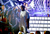 Recording artist Kanye West accepts the Video with a Social Message award for Big Sean's 'One Man Can Change The World' onstage during the 2015 MTV...