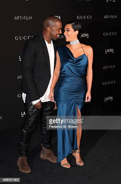 Recording artist Kanye West and Kim Kardashian West attend the 2014 LACMA Art Film Gala honoring Barbara Kruger and Quentin Tarantino presented by...