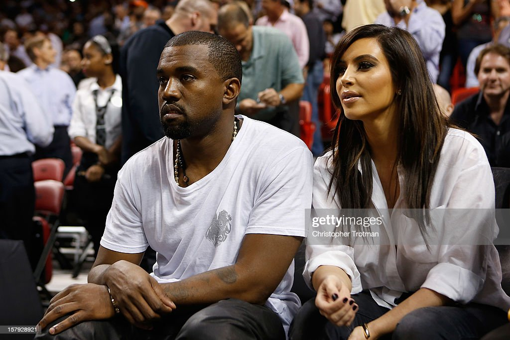 Recording Artist Kanye West and Reality Star Kim Kardashian attend a basketball game between the New York Knicks and Miami Heat at American Airlines Arena on December 6, 2012 in Miami, Florida.NOTE