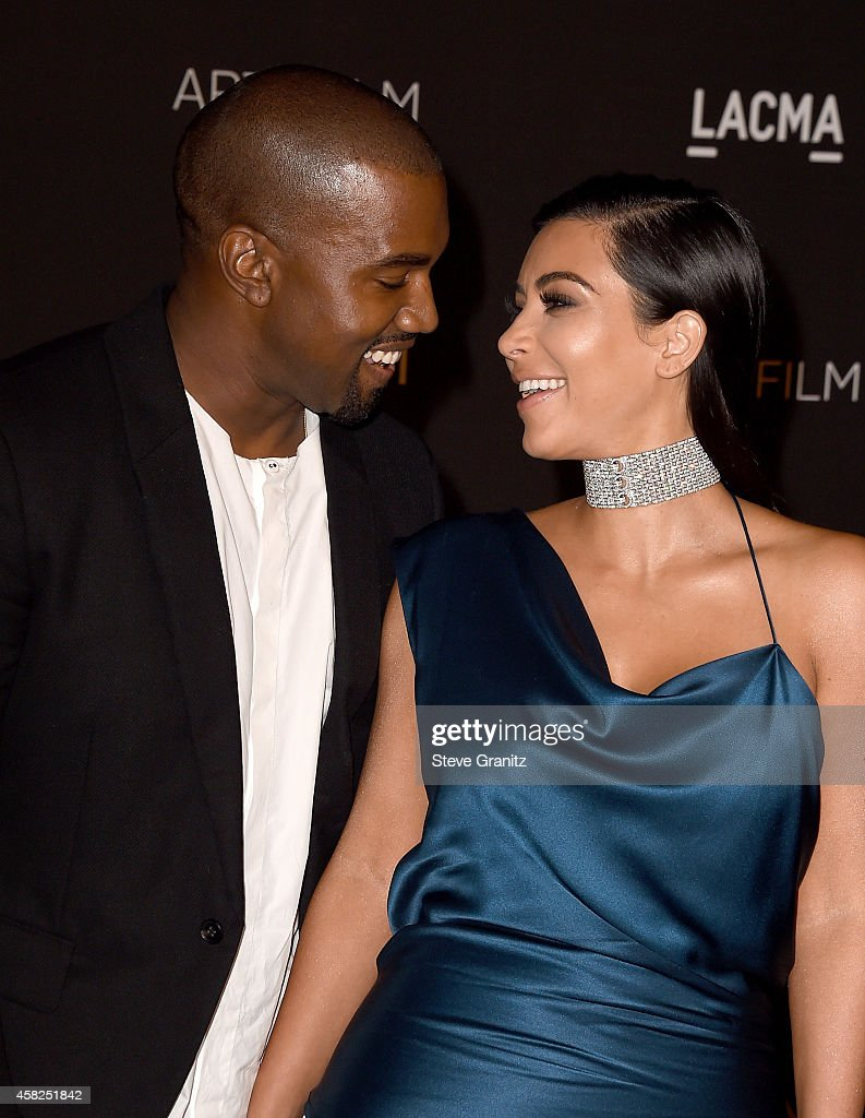 Recording artist Kanye West (L) and TV personality Kim Kardashian West attend the 2014 LACMA Art + Film Gala honoring Barbara Kruger and Quentin Tarantino presented by Gucci at LACMA on November 1, 2014 in Los Angeles, California.