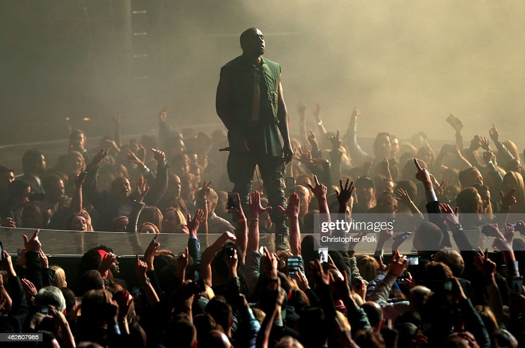 Recording artist Kanye West performs onstage during DirecTV Super Saturday Night hosted by Mark Cuban's AXS TV and Pro Football Hall of Famer Michael Strahan at Pendergast Family Farm on January 31, 2015 in Glendale, Arizona.
