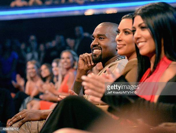 Recording artist Kanye West with TV personalities Kim Kardashianand Kourtney Kardashian during the 2015 MTV Video Music Awards at Microsoft Theater...