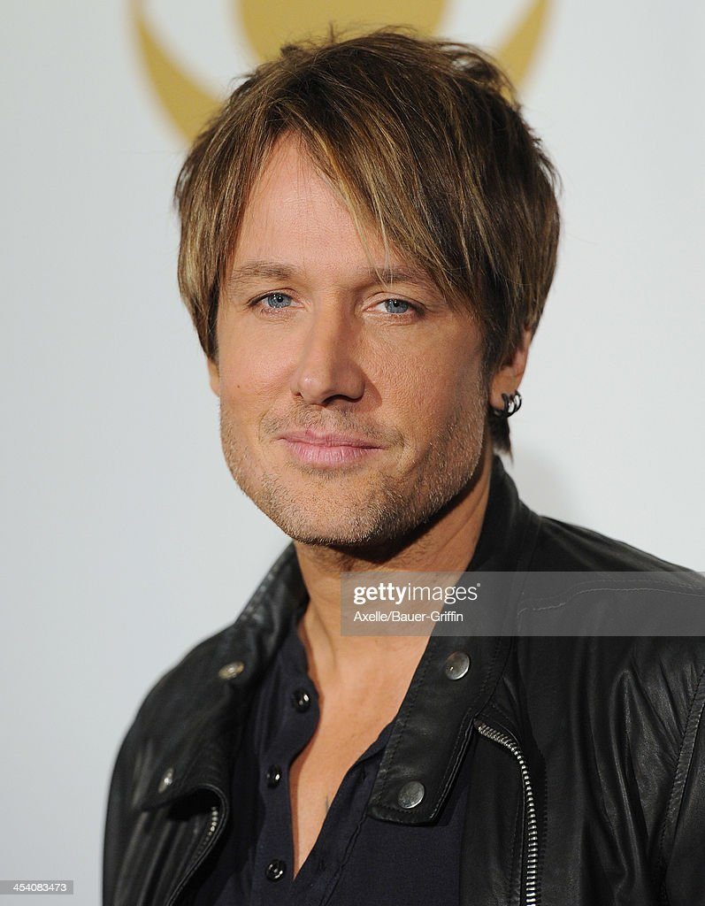 Recording artist Keith Urban poses in the press room at The GRAMMY Nominations Concert Live! Countdown To Music's Biggest Night at Nokia Theatre L.A. Live on December 6, 2013 in Los Angeles, California.