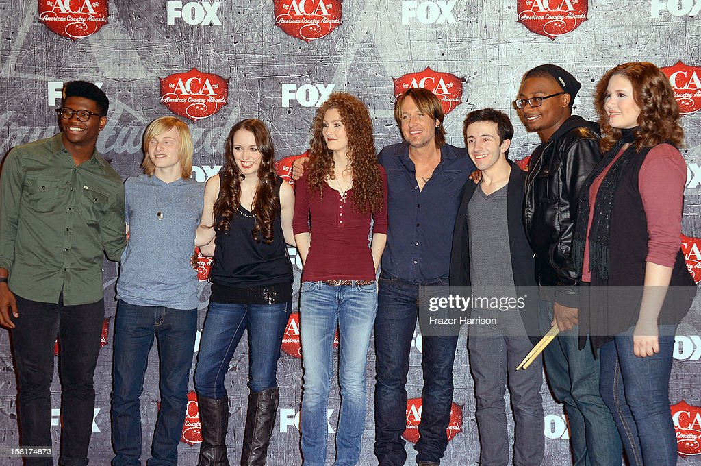 Recording artist Keith Urban (5th L) poses in the press room with GRAMMY Camp Music scholarship winners during the 2012 American Country Awards at the Mandalay Bay Events Center on December 10, 2012 in Las Vegas, Nevada.