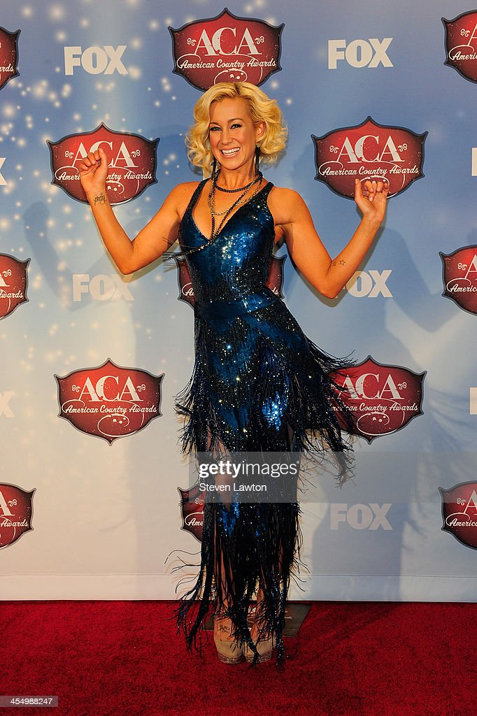 Recording artist <a gi-track='captionPersonalityLinkClicked' href=/galleries/search?phrase=Kellie+Pickler&family=editorial&specificpeople=600021 ng-click='$event.stopPropagation()'>Kellie Pickler</a> poses in the press room during the American Country Awards 2013 at the Mandalay Bay Events Center on December 10, 2013 in Las Vegas, Nevada.