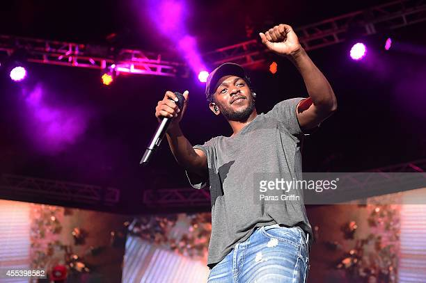 Recording artist Kendrick Lamar performs onstage during 2014 ONE Musicfest at Aaron's Amphitheater at Lakewood on September 13 2014 in Atlanta Georgia
